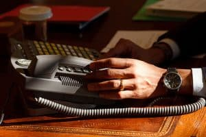 Picture of Businessman Hand twilight zone phone calls On Telephone