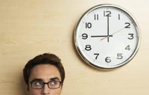 crop image of man staring at 30 minute webinars clock