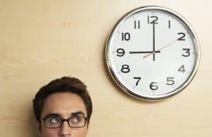 crop image of man staring at 30 minute webinars clock