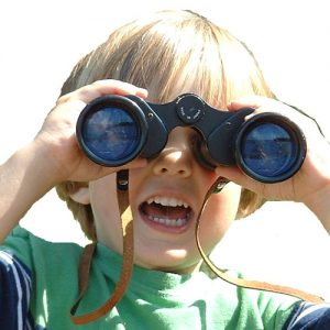 picture of boy looking at workers compensation medical software binoculars