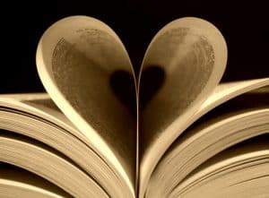picture of workers comp documents book folded to look like a heart