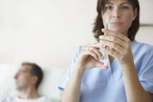 Nurse medical treatment networks preparing syringe injection