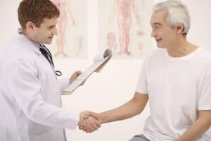 Doctor and Patient medical treatment networks shaking Hands