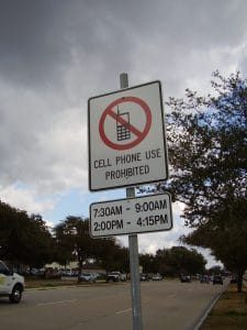 Street Sign of workers compensation accident Cellphone Prohibited