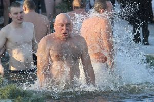 picture of man swimming workers comp claim analytics