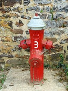 picture of fire hydrant with 3 workers comp program fixes on it