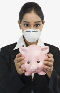 Businesswoman coronavirus return to work wearing H1N1 mask and holding a piggy bank