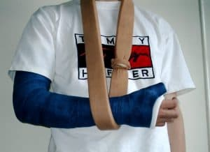picture of arm in sling workers comp claim denial
