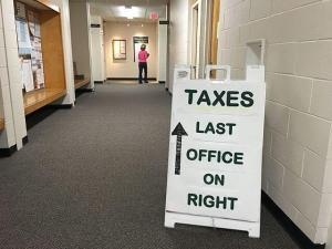 Signage of Taxes office IRS Dirty Dozen at the side floor