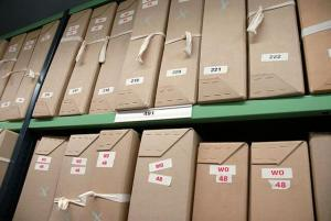 Boxes of workers comp email documents repository shelve