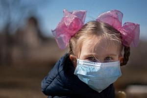 Child in medical mask physical premium audits during coronavirus pandemic