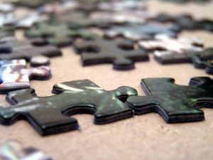 A puzzle pieces of workers comp premium auditor's job will come together