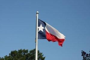 Texas Flag COVID-19 Vaccination Reaction Claims raising