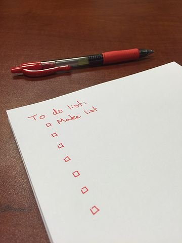 to do list on workers comp accident bond paper and pen