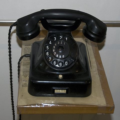 Old telephone workers comp training color black