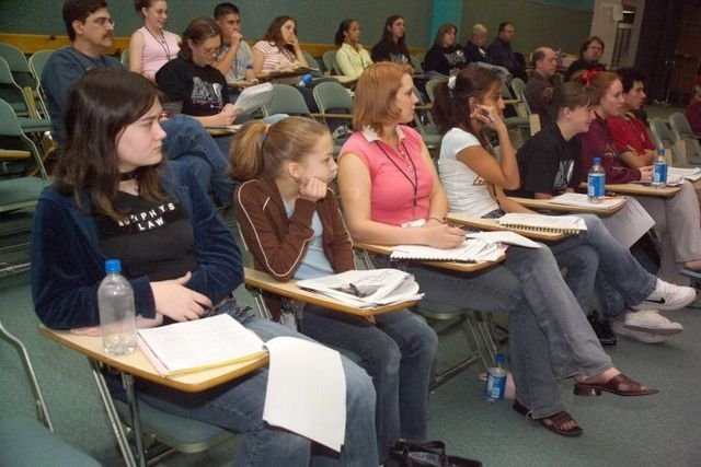 High school insurance interns students sitting and listening