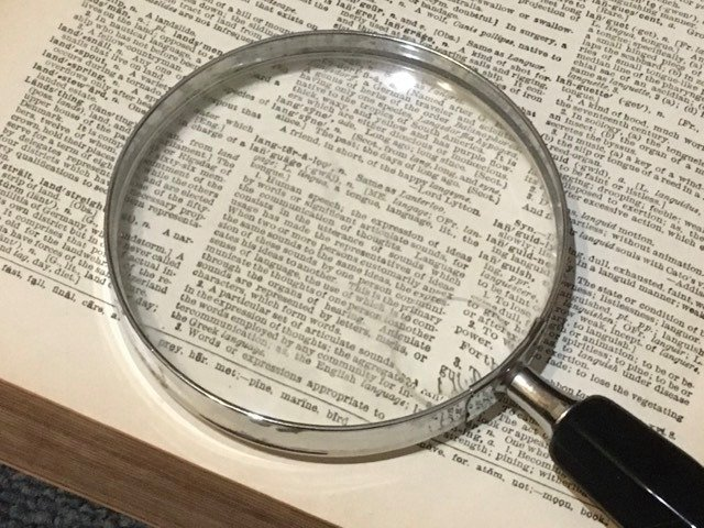 Magnifying glass workers comp benefits quiz top of book